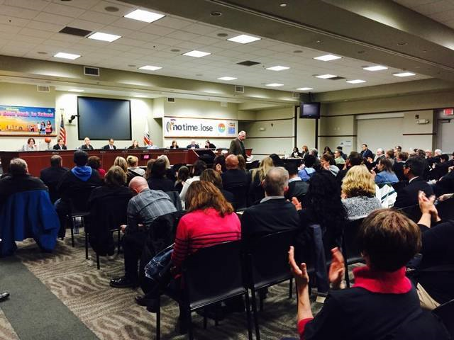Image: A full house at a previous Sacramento USD Board of Education Meeting. Rows are full of people.